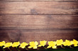 Yellow narcissus flowers on brown wooden table
