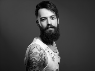 handsome man with beard and tattoo