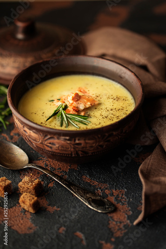 Fish cream soup with Salmon, cheese, Potatoes and herbs in white Soup Bowls. - 252925876