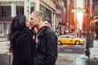 Happy tourist couple in love is kissing and travelling in New York City
