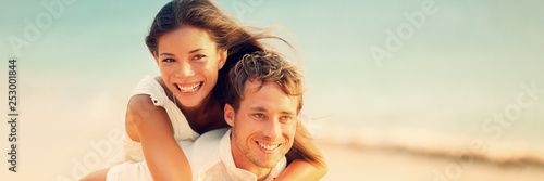 Banner of happy young people in love piggybacking on beach honeymon vacation background. Couple lovers interracial woman and man .