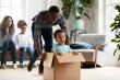 Leinwandbild Motiv Happy black family play with kids moving to new home