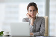 Leinwandbild Motiv Confused businesswoman annoyed by online problem looking at laptop