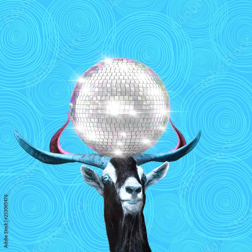 Contemporary art collage, goat holds disco ball on the horns - 253065476