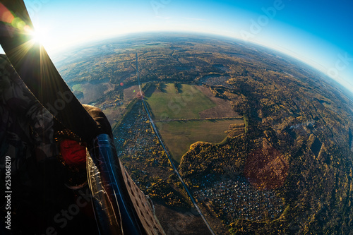 Aerial, aerostat view of the suburban area of the city of Izhevsk with roads, villages and autumn forest. Russia - 253068219