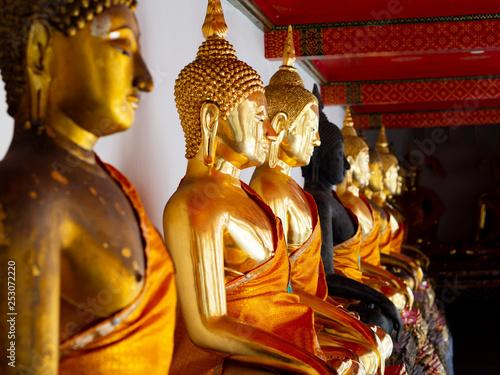 Beautiful gold Buddha statues in Wat Pho - Bangkok, Thailand - Buddhist Temple