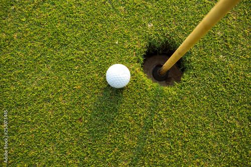 Leinwandbild Motiv Golf ball In the hole