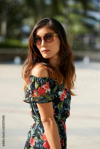 obraz lub plakat Trendy Asian woman looking at camera