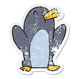 distressed sticker of a cartoon penguin