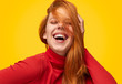 Laughing model touching ginger hair