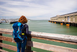Young woman is looking at the Pier 39 in San Francisco, United States of America