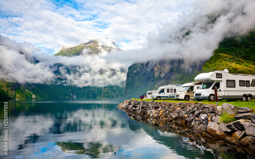 Leinwandbild Motiv Campervan RV vehicles at norwegian camping by a fjord