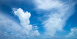 blue sky background with tiny clouds - 253115474