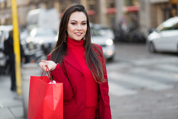 Young woman with shopping bags in Milan, Italy