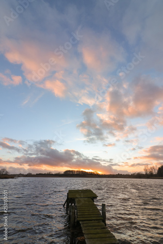 Acrylglas Pier sunset at the lake with jetty as natural burial concept