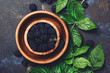 Fresh blackberries with leaves in wooden bowl, copy space, top view