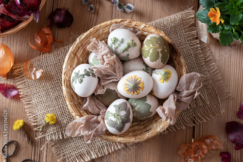 Leinwandbild Motiv Preparation of Easter eggs for dying with onion peels