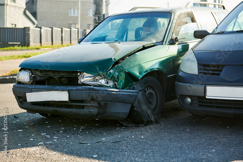 car crash accident on street. damaged automobiles - 253167813