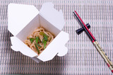 Eastern dish in a carton box. Eastern cuisine. Food delivery.