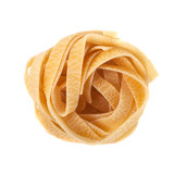 Uncooked nest of tagliatelle Italian pasta isolated on white background
