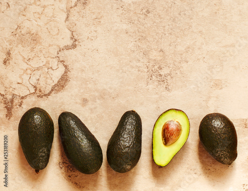 Fresh Avocado. Frame, top view, flat lay, copy space - 253189200