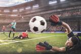 Fototapeta Sport - goalkeeper jumping for the ball on football match © 27mistral