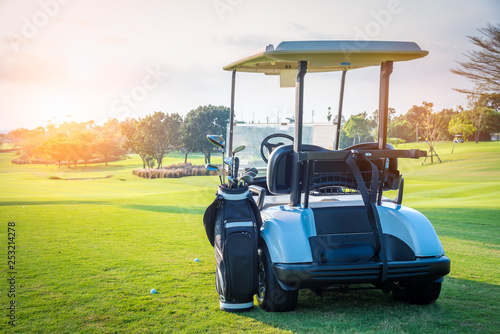 Golf cart park on green grass in golf course ,beautiful view of golf course and sun sky background - 253214278