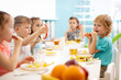 Group of kindergarten students eating healthy food lunch break together