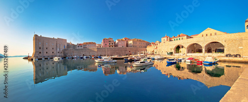 canvas print picture Dubrovnik harbor and city walls morning panoramic view