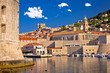 canvas print picture Historic Dubrovnik harbor and strong walls view