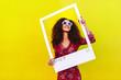 Leinwanddruck Bild - Female blogger photographing for her social network post