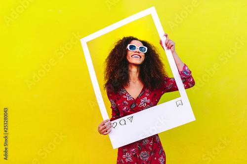 Leinwanddruck Bild Female blogger photographing for her social network post