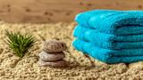 Wellness - ręczniki, kamienie i bambus na piasku