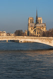 Fototapeta Paryż - Notre-Dame cathedral and river Seine at sunrise in Paris, France © LP2Studio