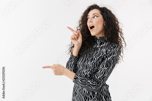 Portrait of a cheerful attractive woman wearing bright clothes - 253293216