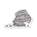 distressed sticker of a cartoon large rock