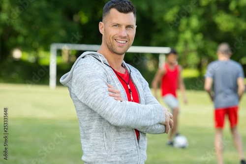 portrait of handsome male football coach