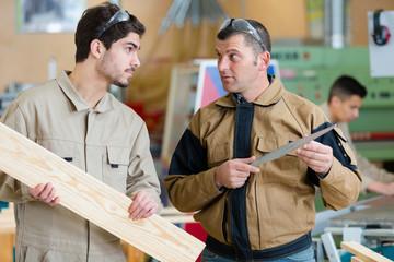 men buying wood