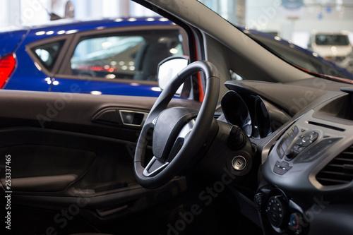 Interior of new car at dealer showroom. Modern transportation. - 253337465