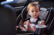 Cute baby girl in car seat