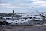 moderate storm in baltic sea near lighthouse