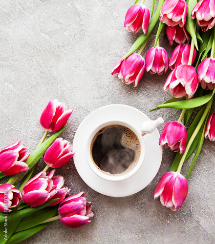 Cup of coffee and tulips