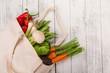 Leinwandbild Motiv Fresh vegetables in bio eco cotton bags on old wooden table. Zero waste shopping concept. Plastic free.