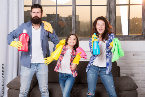 hygiene. We will make your world spotless. Family clean house. Happy family hold cleaning products. Mother, father and daughter clean house. hygiene at home. Love hygiene. hygiene makes us healthy