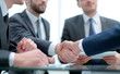 Leinwanddruck Bild - Business handshake and business people concept.