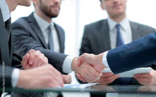 Leinwanddruck Bild Business handshake and business people concept.