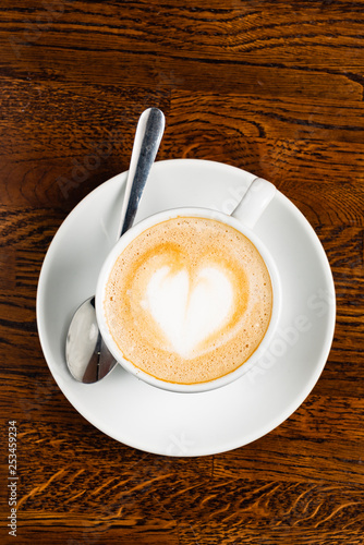 cappuccino with heart shape on the wooden table, top view - 253459234