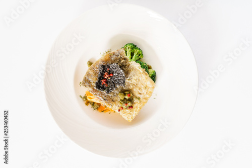 fish with vegetables, top view - 253460482
