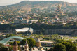 View from the hill to Tbilisi city with the bridge of Piece through Kura river and other landmarks. Georgia 2018 summer - 253476051