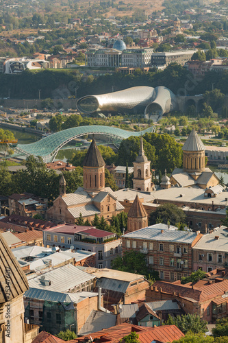 View from the hill to Tbilisi city with the bridge of Piece through Kura river and other landmarks. Georgia 2018 summer - 253476017